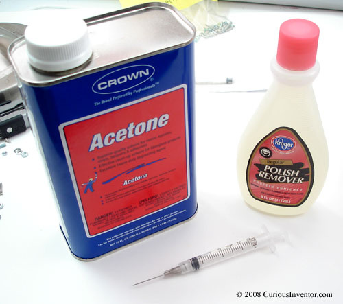 Tools for joining acrylic: acetone and a syringe