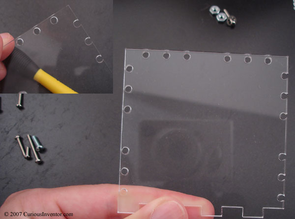 screw holes cut into acrylic varying distances from the edge