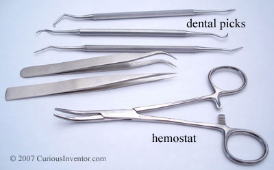 Dental picks, tweezers and a hemostat